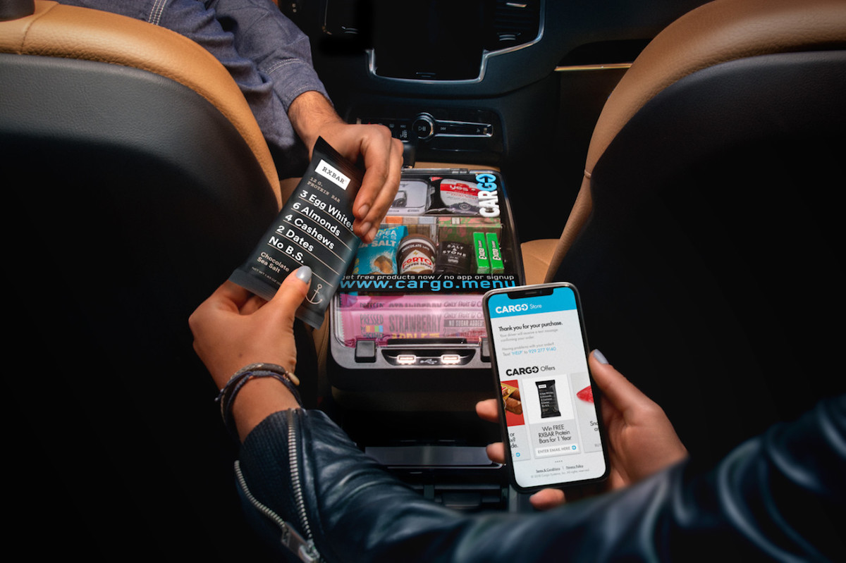 uber riders in select cities can now buy snacks electronics and more following partnership with cargo