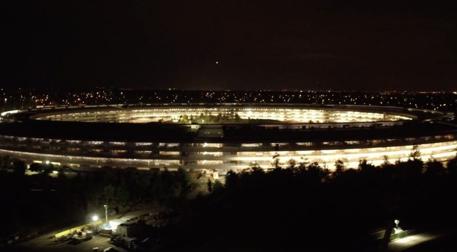 photo image New Drone Footage Shows Nearly Complete Apple Park Campus at Night