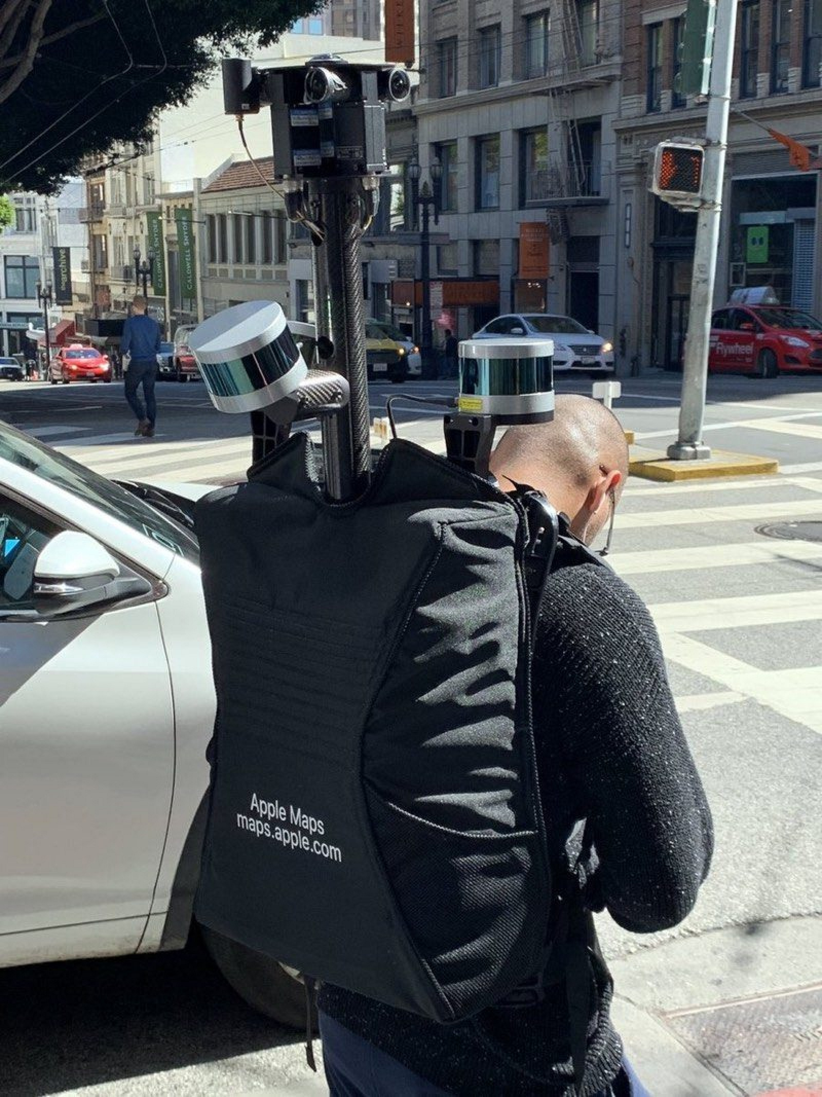 Man Wearing Apple Maps Backpack Surveying San Francisco on Foot
